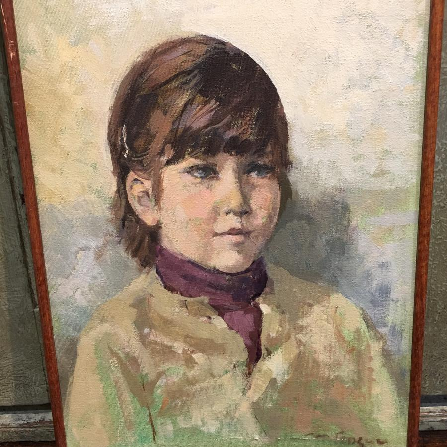 Framed oil painting of child
