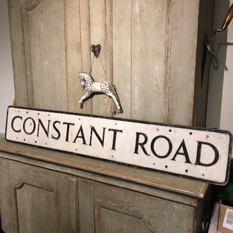 "Vintage road sign ""Constant Road"""