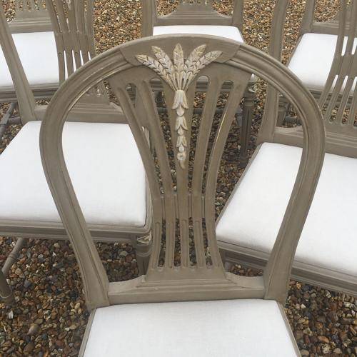 Six 1950s painted Swedish dining chairs with natural linen seats