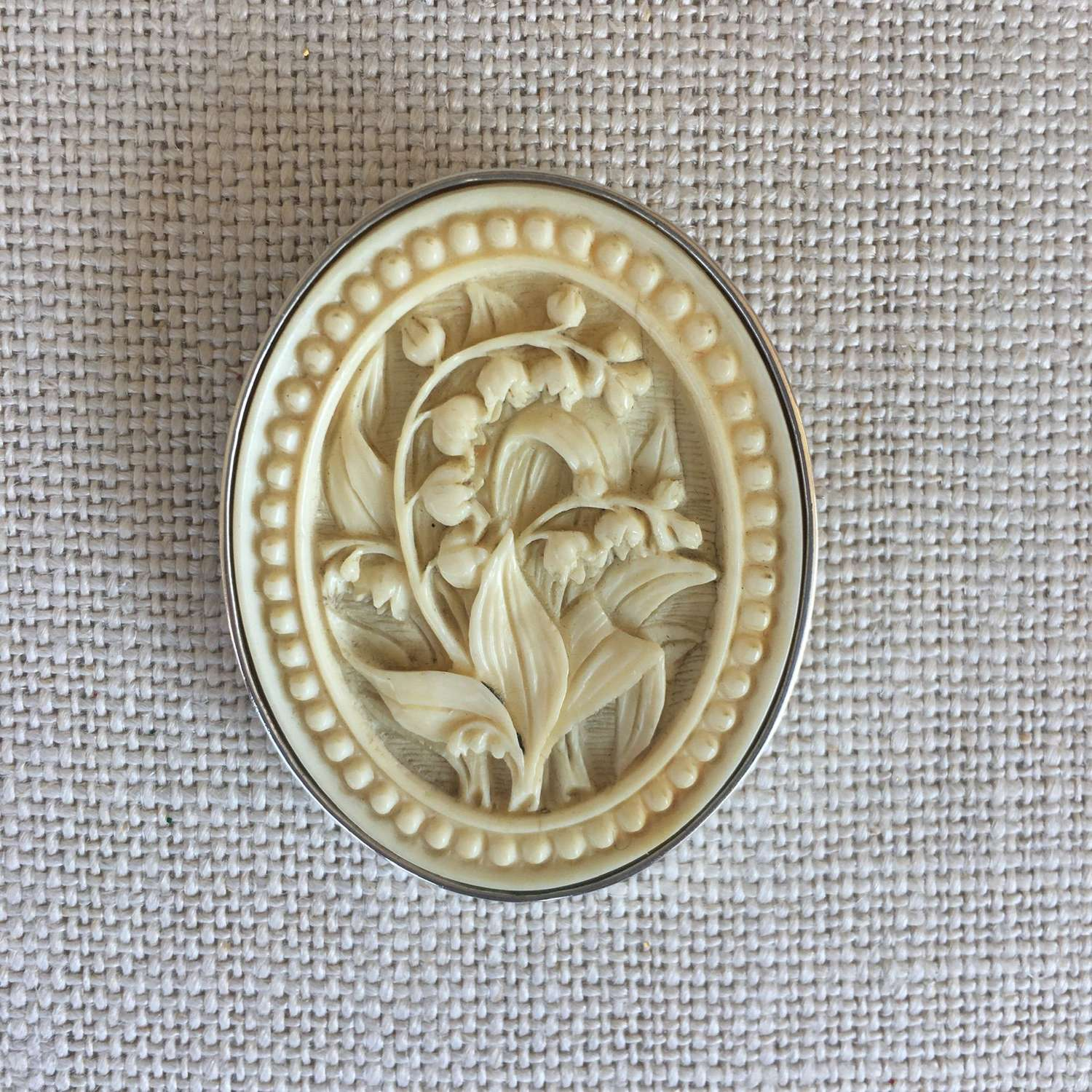 Oval celluloid floral cameo silver framed