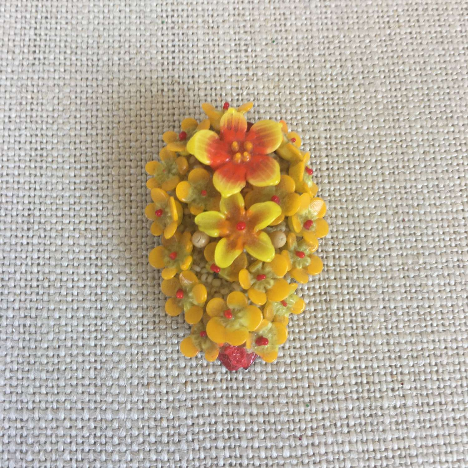 Vintage plastic yellow red floral dress clip