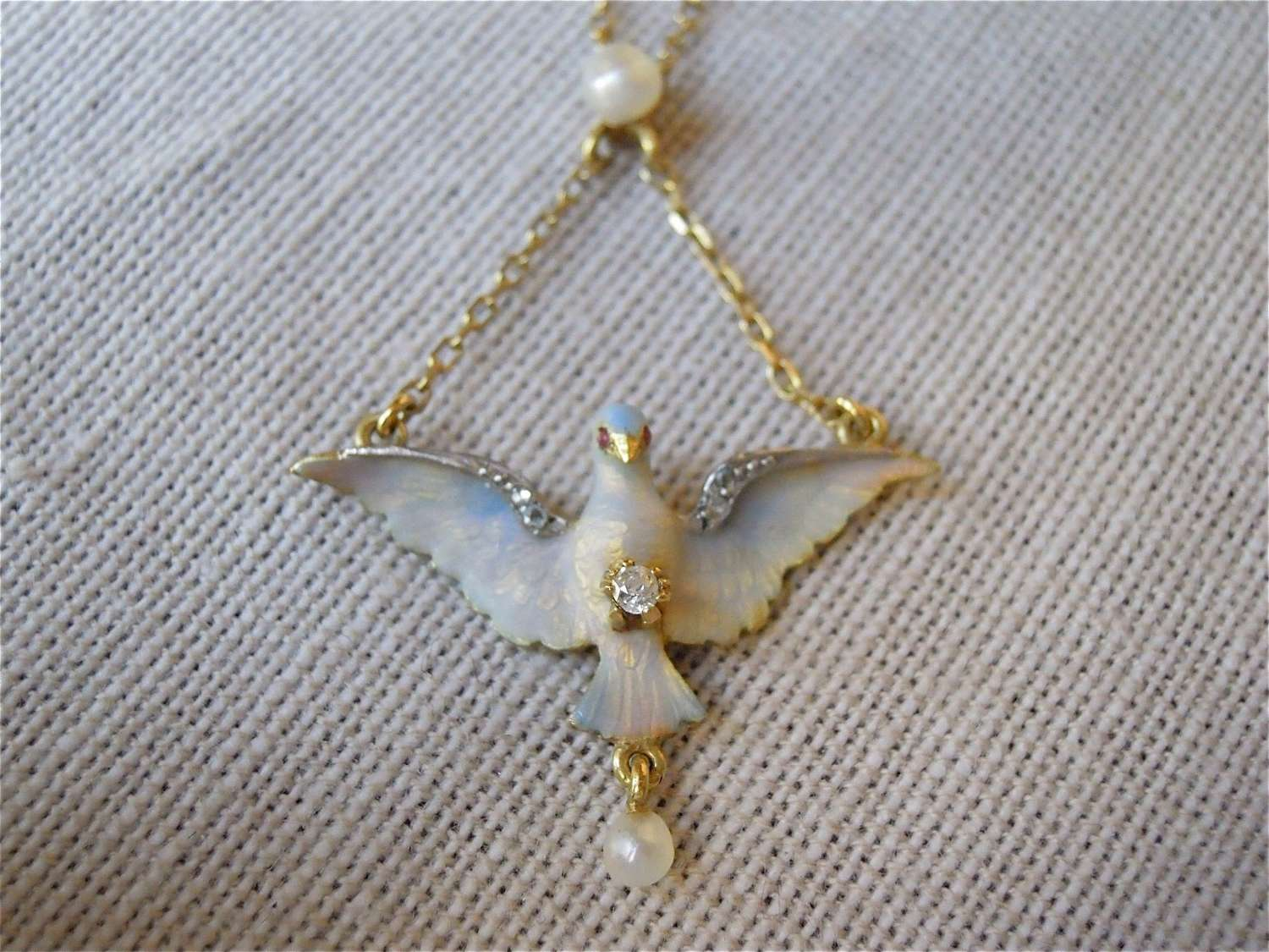 Antique 18ct gold, enamel, pearl and diamond pendant of bird