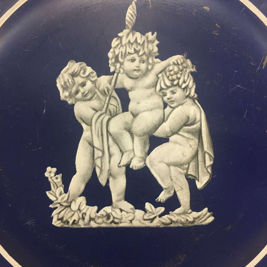 Vintage biscuit tin with putti and classical decoration
