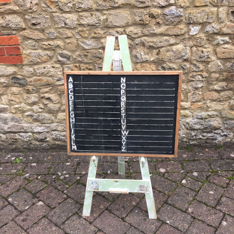 Vintage green painted easel and blackboard