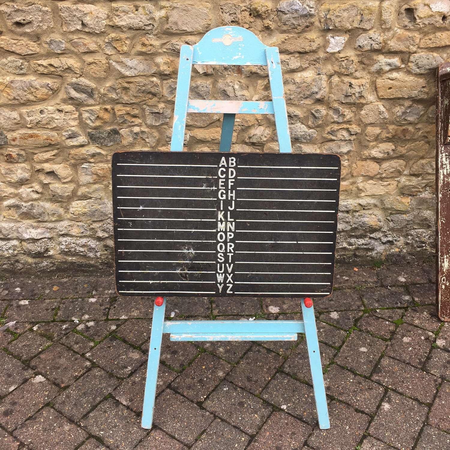 Vintage blue painted easel and blackboard