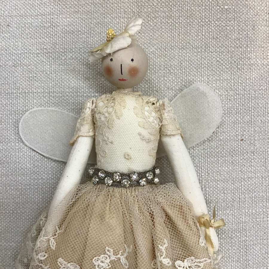 Handcrafted cloth fairy doll with vintage clothing