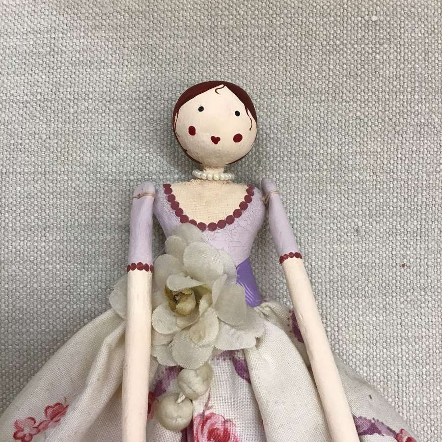 Hand crafted paper clay doll dressed in vintage fabric and trims