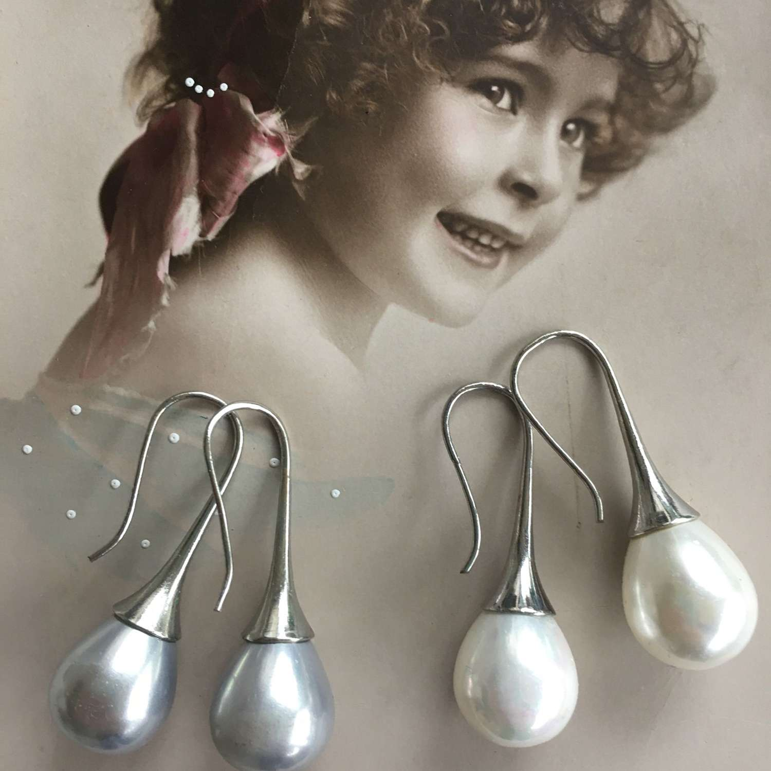 Synthetic pearl drop earrings
