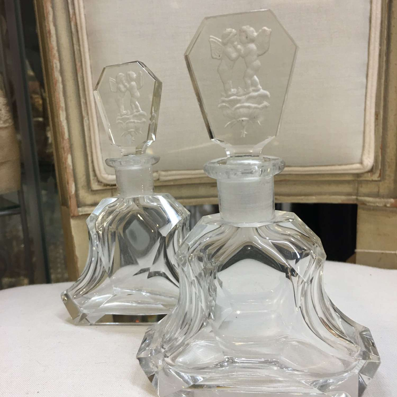 A pair of glass Art Deco perfume bottles