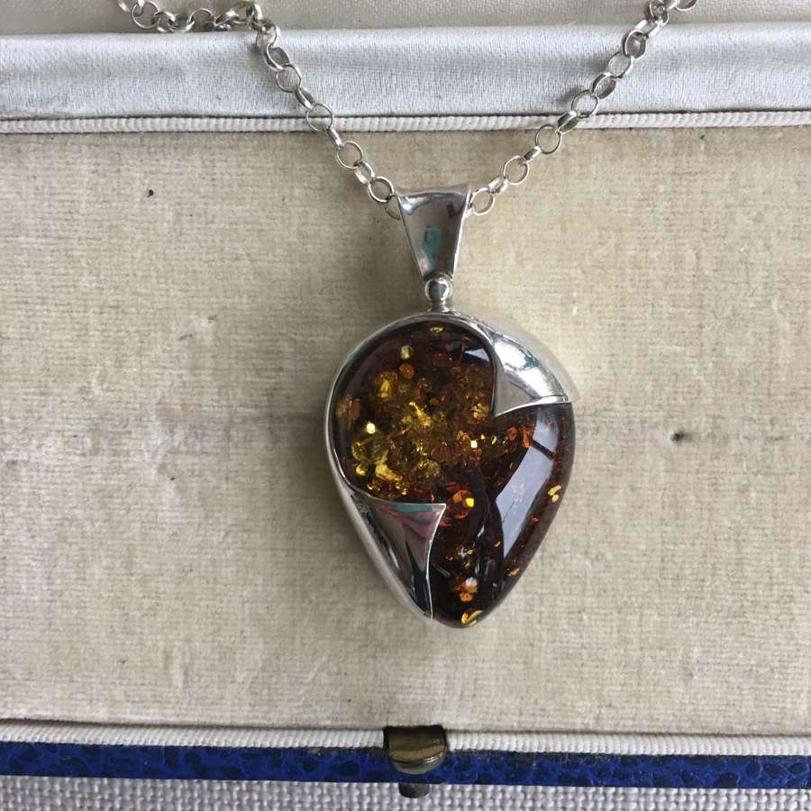 Silver and amber necklace on silver chain