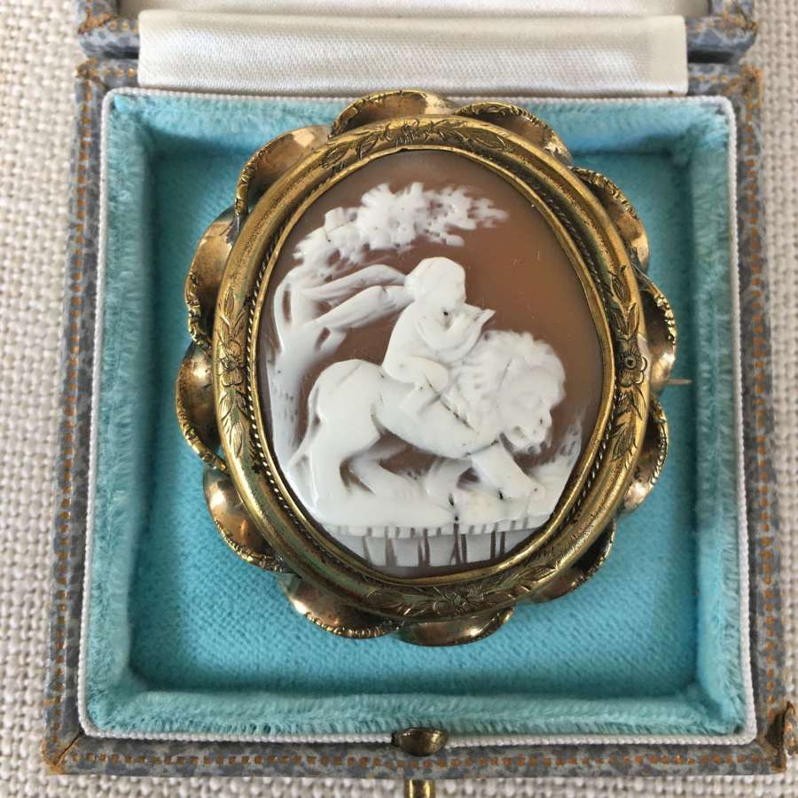 Shell cameo brooch of cherub sitting on lion c 1880