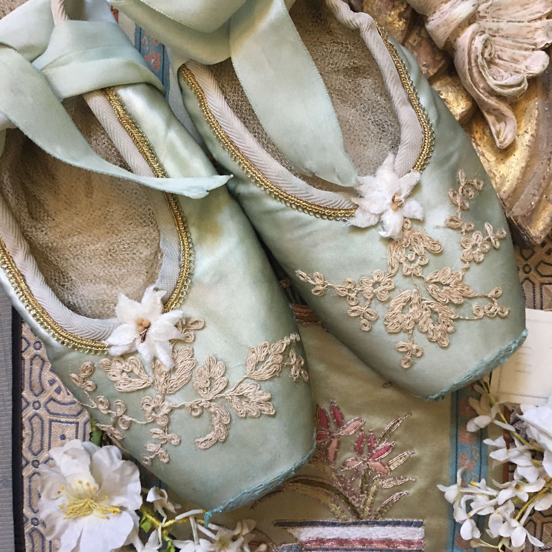 Decorative vintage green satin ballet shoes