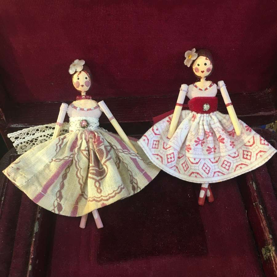 Tiny paper clay dolls with clothing made from vintage fabric and trims