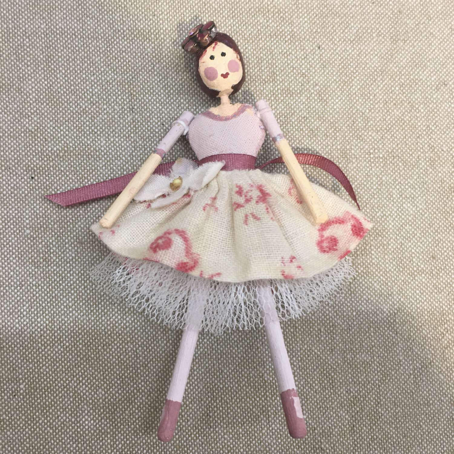 Tiny paper clay doll with vintage fabric dress