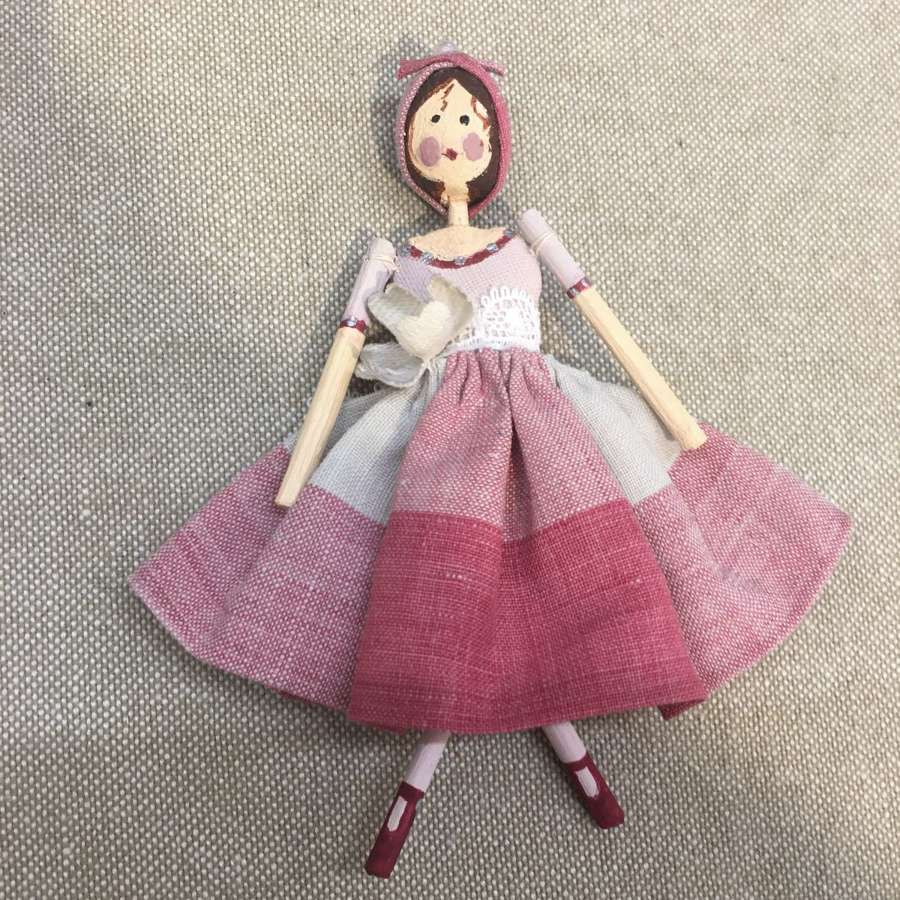 A tiny fairy doll handmade from paper clay with vintage fabrics