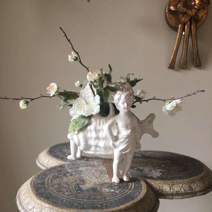 Three putti creamware vase with rose and orange blossom flowers