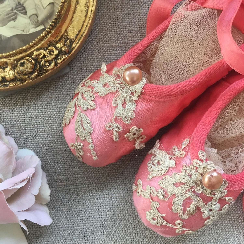 Pretty coral ballet shoes with antique lace