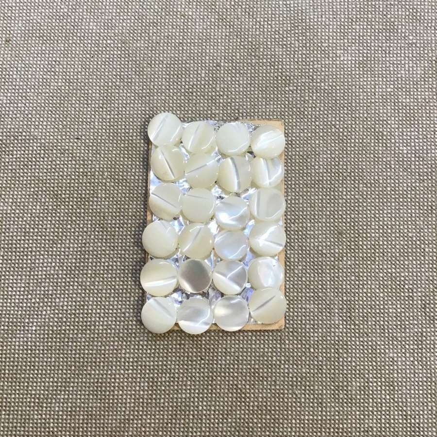 24 small mother of pearl buttons 0.7cm diameter