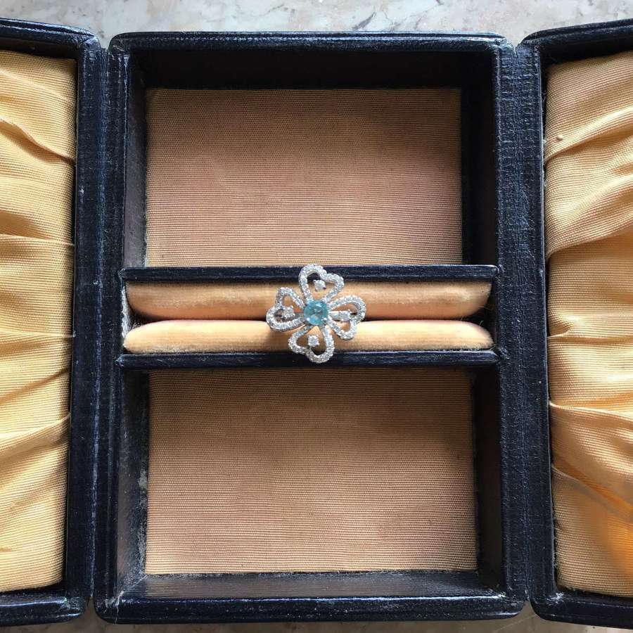 Sterling silver clover ring with blue topaz and cubic zirconia