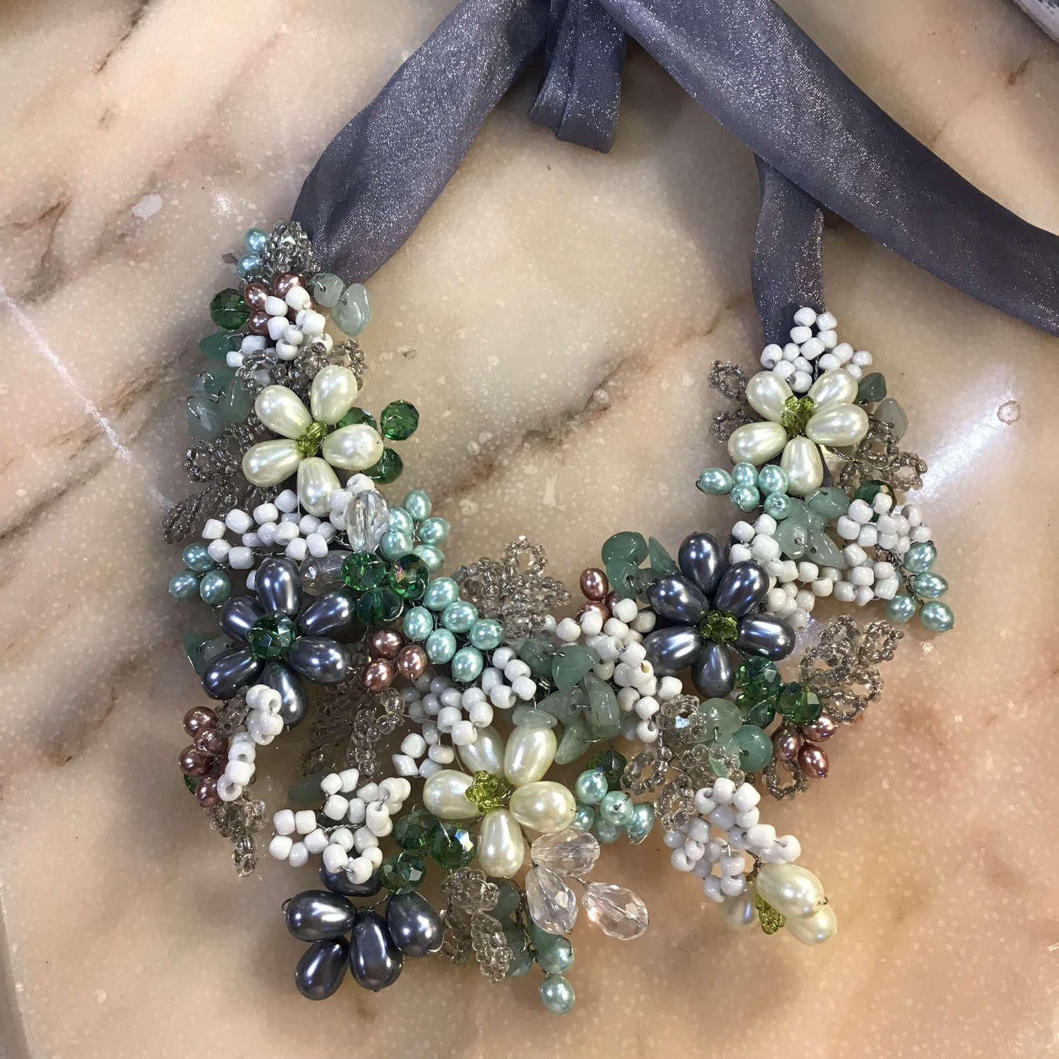Hand beaded wired necklace with ribbon ties