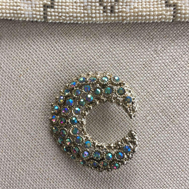 Vintage Aurora Borealis crescent brooch