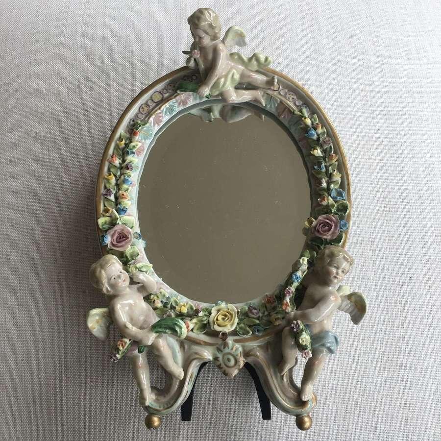 Antique Sitzendorf porcelain cherub mirror